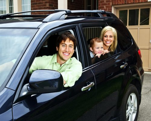 Family in Car- Holiday Travel Tips